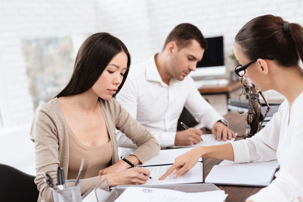 couple consulting lawyer for divorce