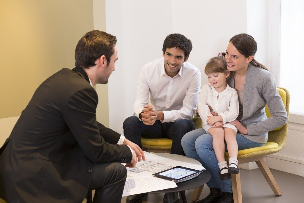 a family talking with a family solicitor