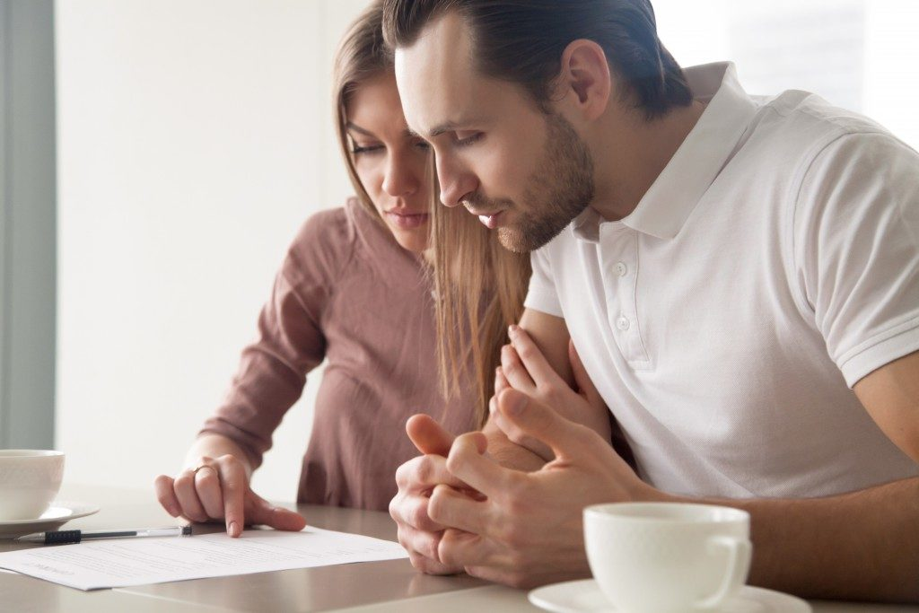 married couple reviewing an article