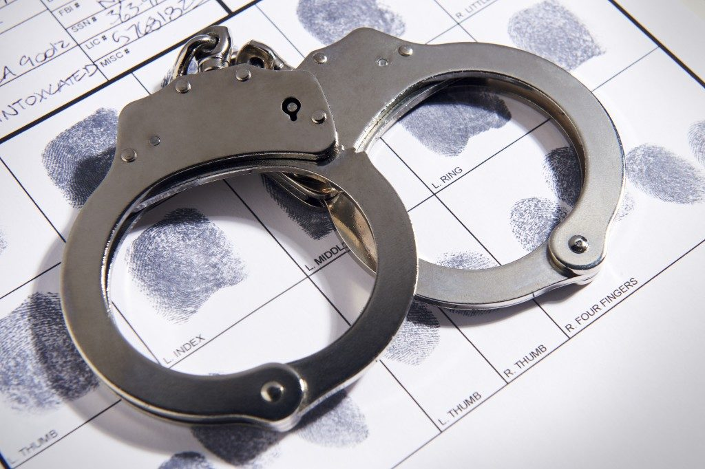 handcuffs on a police file