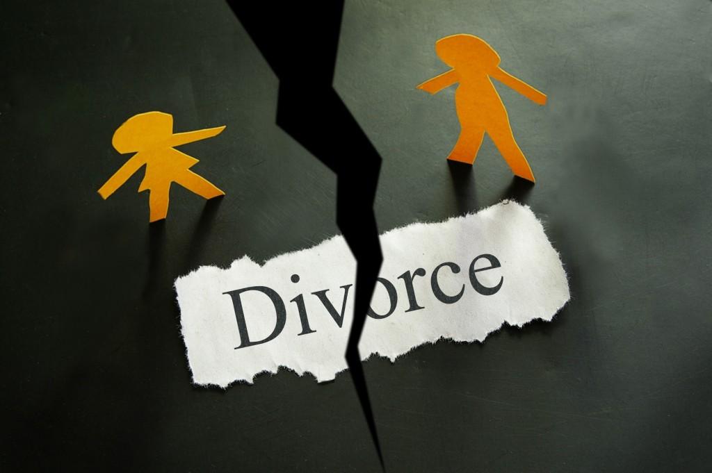 divorce concept on torn paper